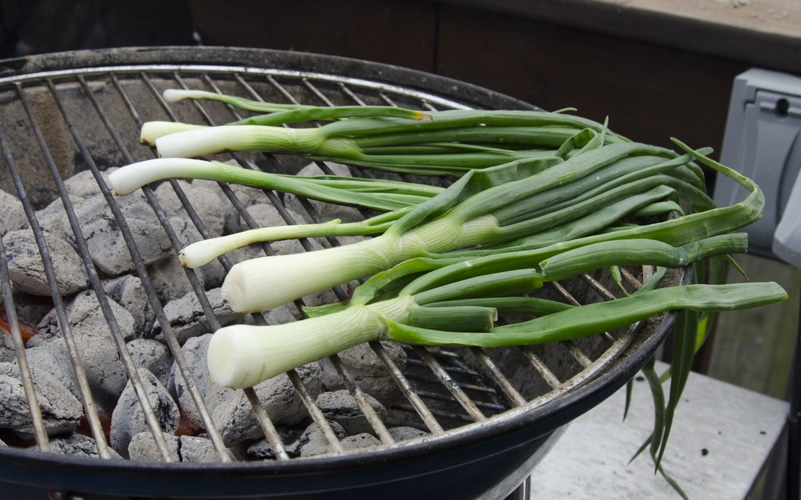 raw calcots on the grill