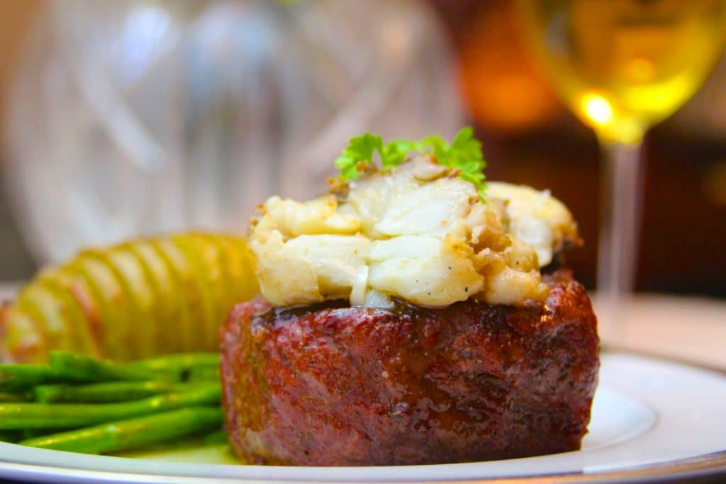 Plated smoked filet mignon with butter poached lobster tail
