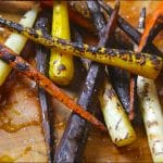 Charred carrots on a cutting board