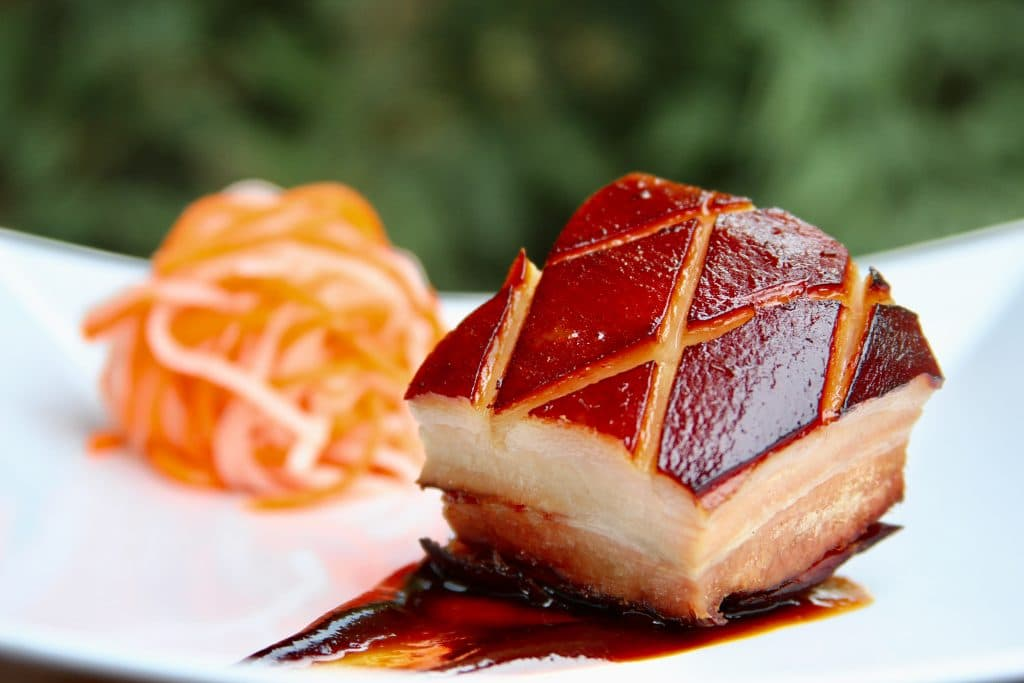 Sous vide and smoked pork belly slice plated