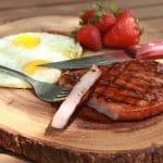 Grilled glazed ham steak plated
