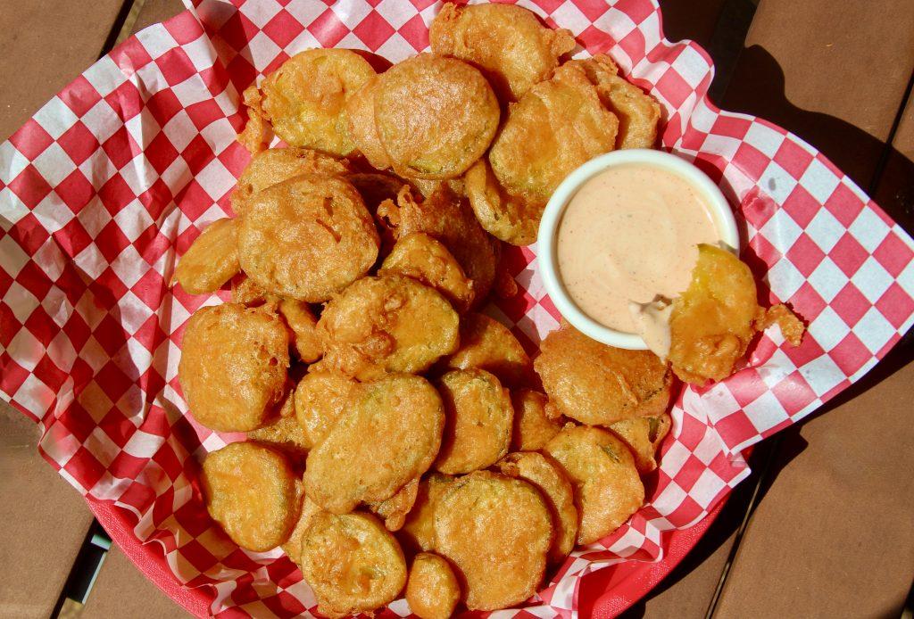 Deep fried pickles in a serving platter