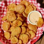 Deep fried pickles in a serving platter