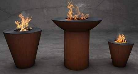 Three beautiful rust colored fire bowls with flames leaping from the centers.
