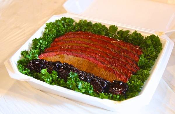 Sliced brisket and burnt ends in a competition BBQ turn-in box