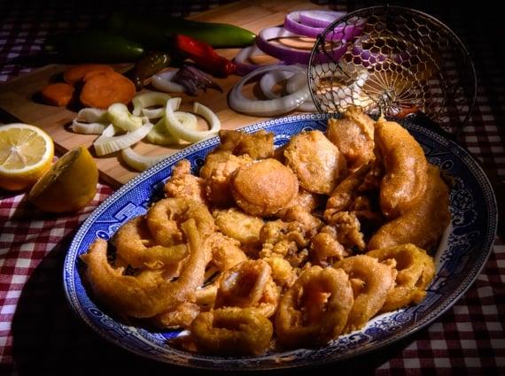 Platter filled with tempura battered fried vegetables