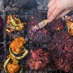 Basting a barbecued maitake mushroom