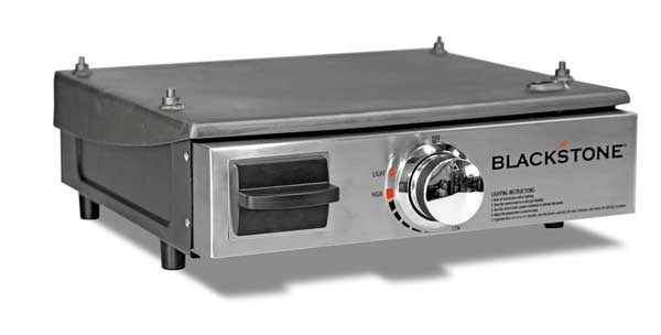 A shiny metal box with a black door on the left and a control knob on the right