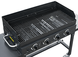 Black boxt gas grill from above. There is no lid and we see the rectangular cooking grate with four burners below.