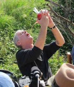 Anthony Bourdain drinking from a porron.