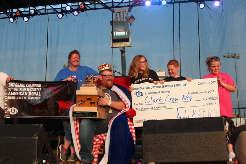 Clark Crew BBQ receiving trophy and check for winning the American Royal World Series of Barbecue