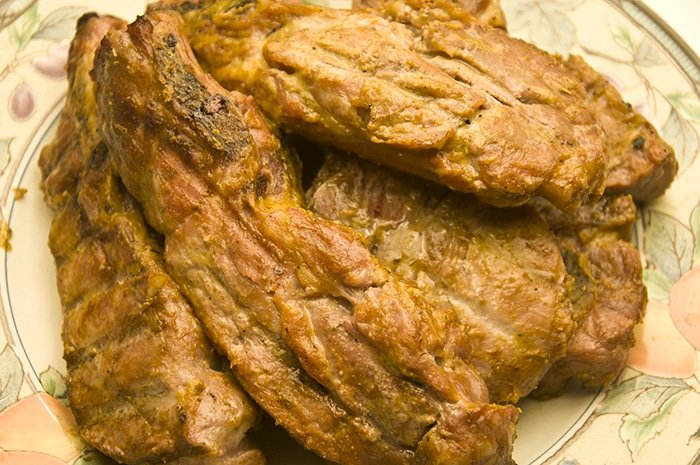 A plate of pork chops with mustard sauce