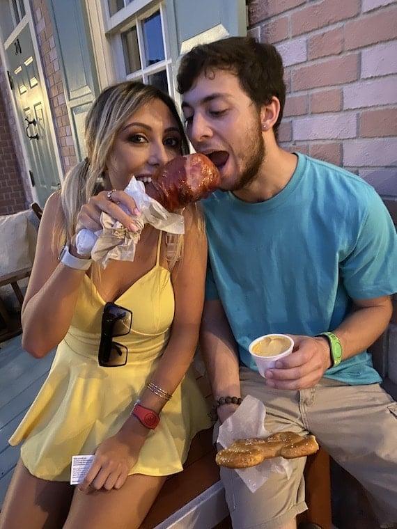 Couple enjoying a smoked turkey leg
