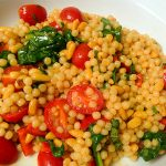 Tomatoes and spinach in a couscous salad