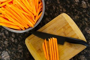 cutting sweet potatoes into fries