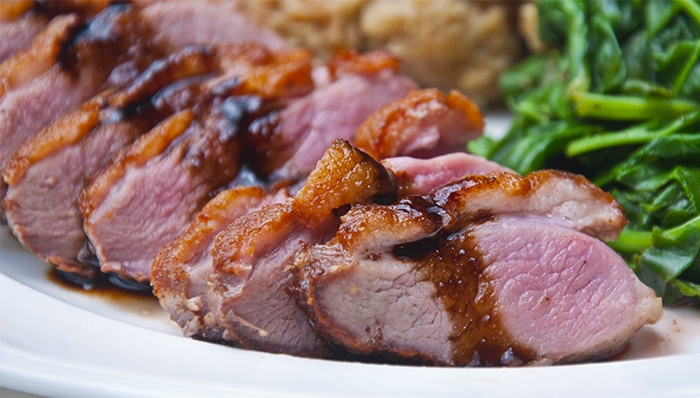 Sliced duck breast with cherry port sauce