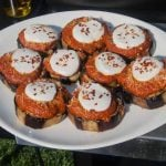 Discs of eggplant topped with tomato sauce and mozarella
