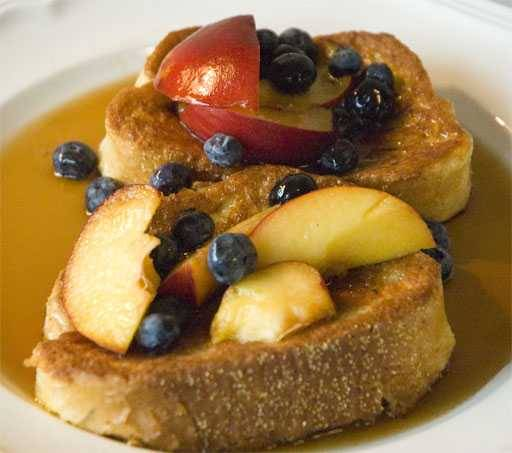 French toasted topped with fresh fruit