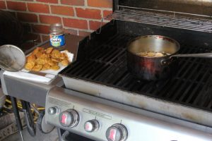 Pot on a grill for deep frying pickle slices