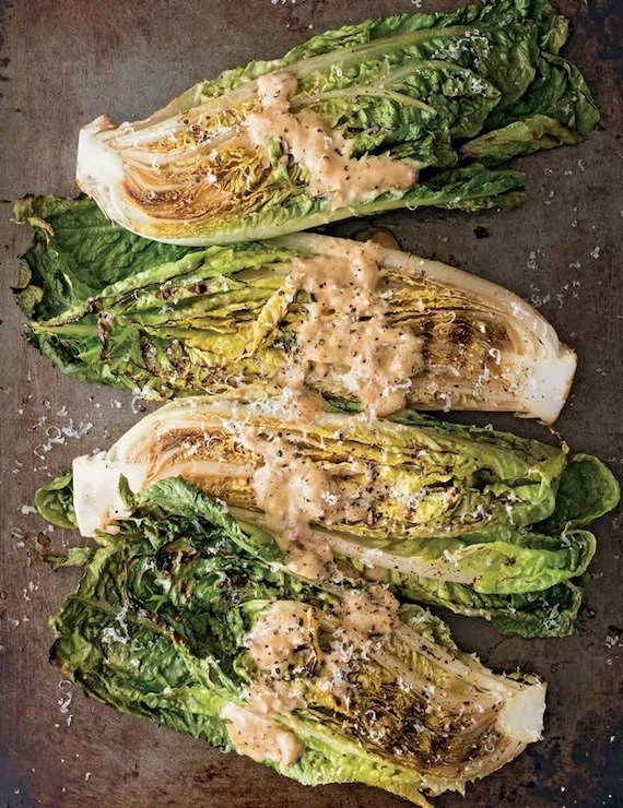Grilled romain quarters sprinkled with Parmesan cheese