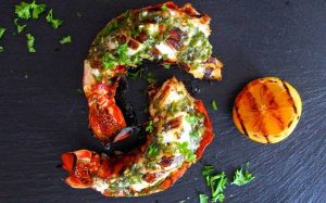 Halved grilled lobster tail