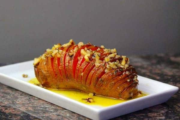 Hasselback sweet potato with pecan butter on plate