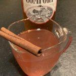Hot Southern Comfort cider in glass with cinnamon stick