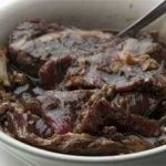 Korean short ribs marinating in a bowl