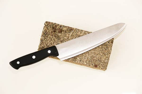 knife blade resting on a stone