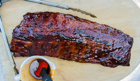 Sauced rack of ribs on a tray