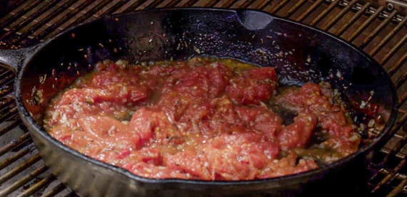 Heating tomato sauce in a skillet