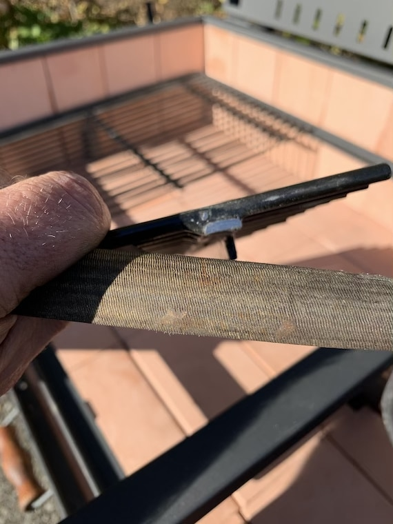 filing down a grill grate