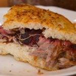 pulled pork onion bread sandwich