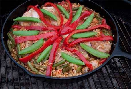 Paella cooking on the grill