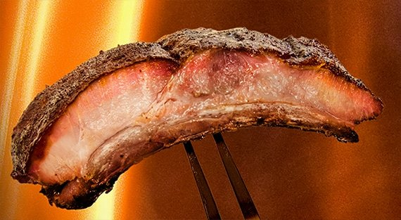 Rib on a fork with flames in the background