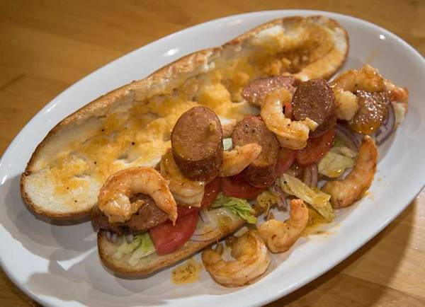 Po boy with lid off showing shrimp and andouille