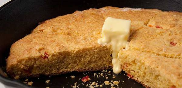 Skillet cornbread topped with butter