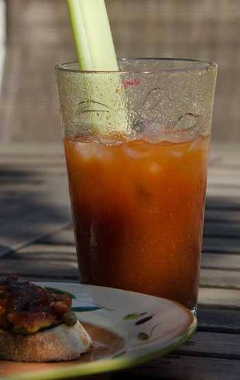 BBQ bloody Mary in glass with celery stalk