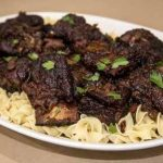 Smoked and braised short ribs on egg noodles