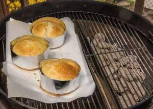 Brioche buns baking on a grill