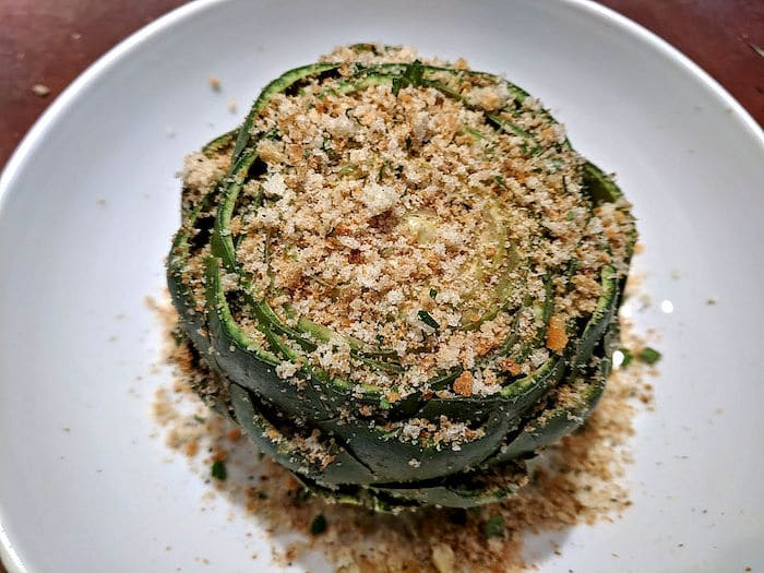 Cooked artichoke with breadcrumb topping