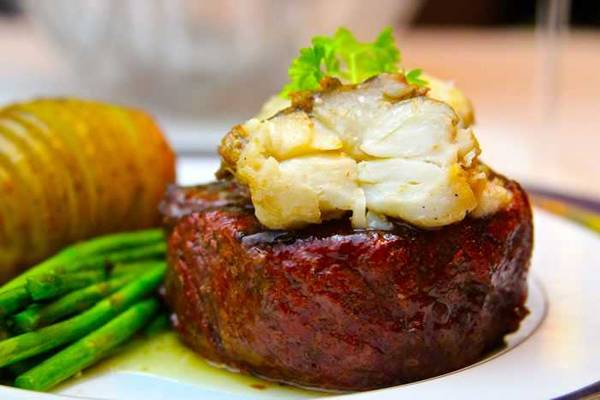 Plated filet mignon topped with lobster tail