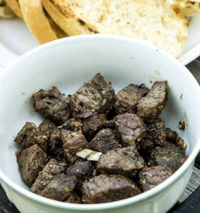 Cooked beef tenderloin chunks in a bowl