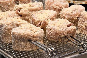 Breadcrumb coated skewered chicken pinwheels