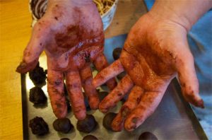 Chocolate coated hands