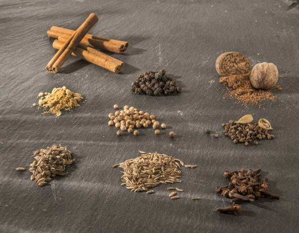 garam masala spices on a black board, waiting to be combined