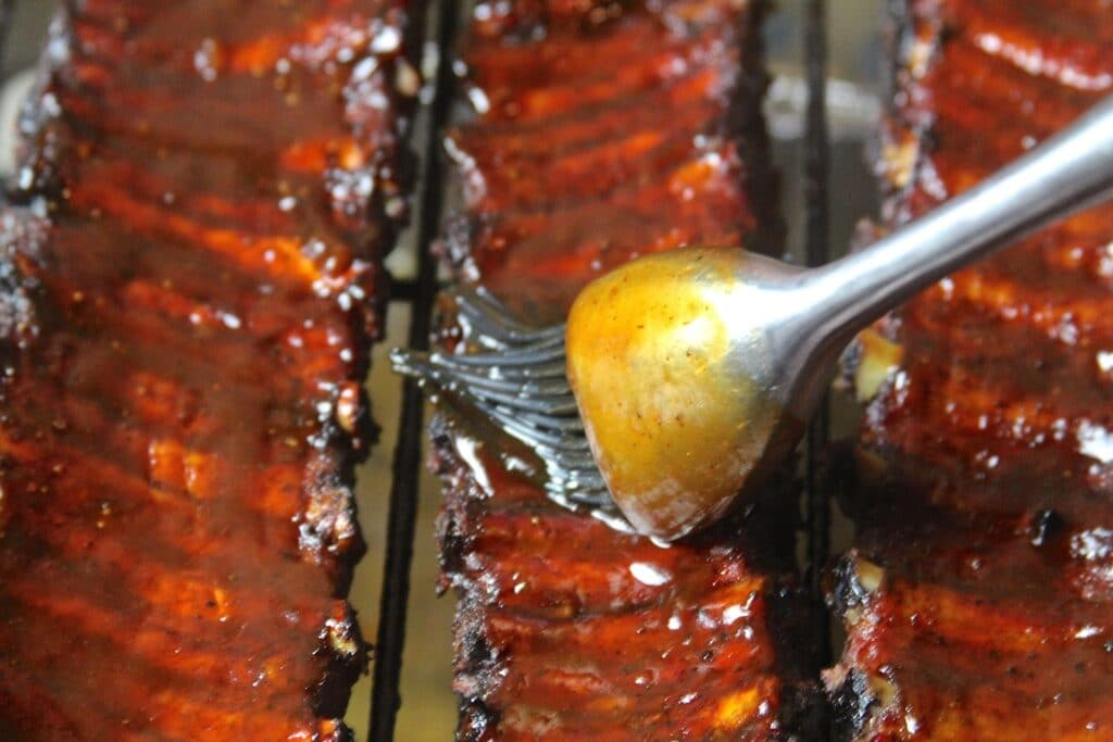 ribs being sauced